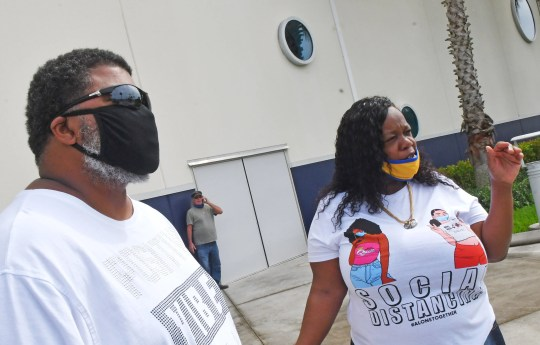 Bobby Deriso and Tracy Wade, members of the International Longshoreman's Association at Port Canaveral, were among those attending the rally