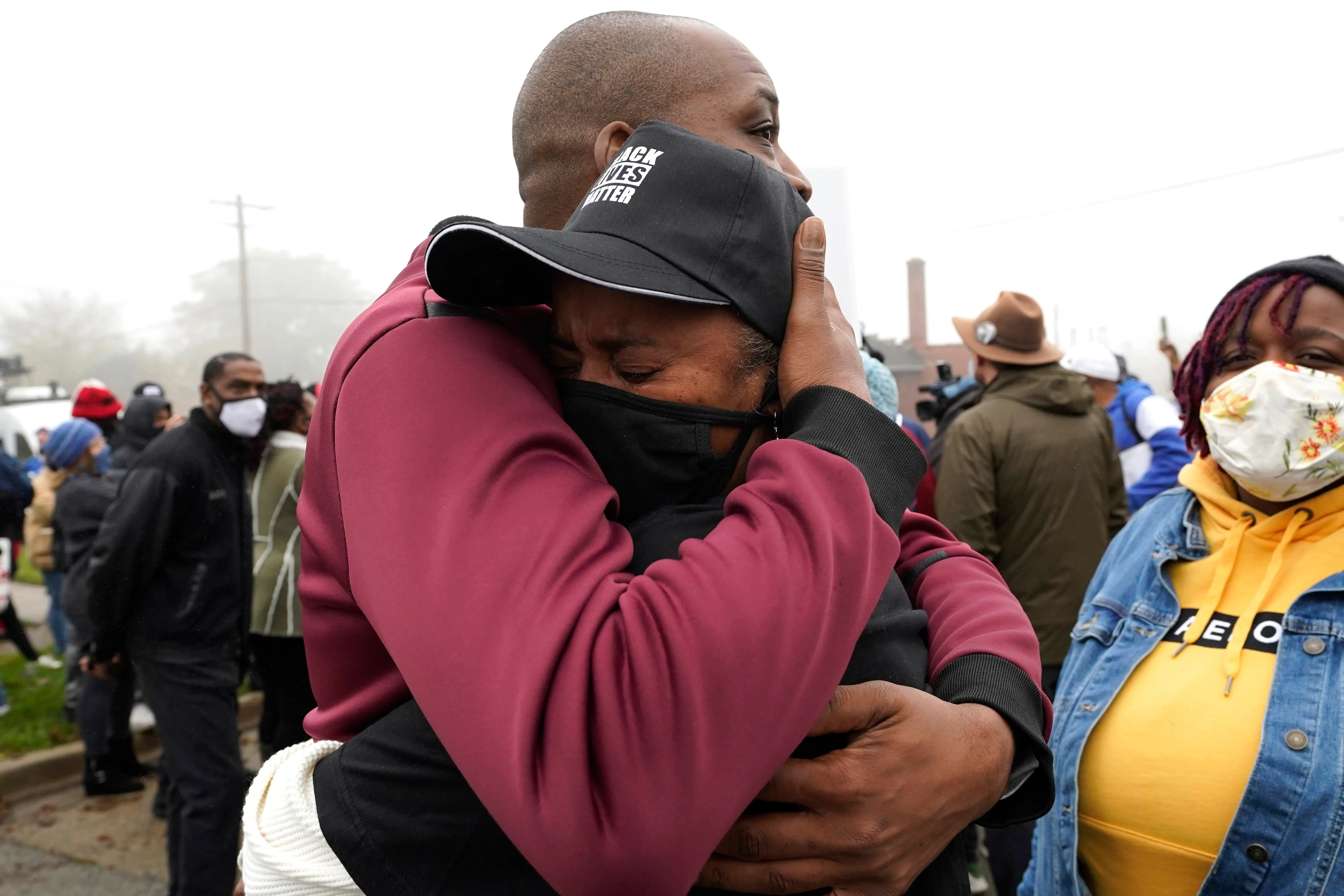 Marcellis Stinnette's grandmother Sherrellis Stinnette, right, cries as she hugs Rayon Edwards during a protest rally for Marcellis Stinnette who was killed by Waukegan Police on Tuesday in Waukegan, Ill. On Thursday 22 October 2020. Stinnette, 19, was killed and his girlfriend and the mother of his child, Tafara Williams, was injured when a Waukegan police officer opened fire on Tuesday evening after police said the vehicle of Williams had started driving towards the officer following a traffic stop.