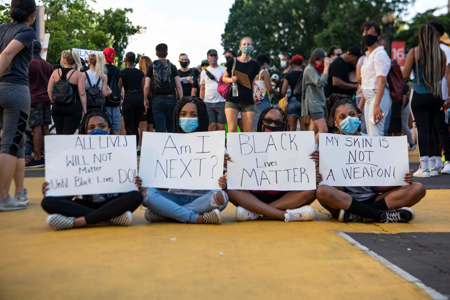 "From left to right, Amari Hawkins, 14, Riley Goins, 15, Kaleigha Kendrick, 14, and Tierra Gibson, 14, hold signs on the newly-renamed ""Black Lives Matter Plaza"" on 16th and I streets in downtown Washington, D.C., on Saturday, June 6, 2020. Protests continued following the death of George Floyd."