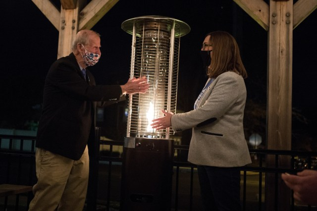 Democratic winner for state senate seat 1 Sarah McBride, right, grabs the figurative torch from retiring senator Harris McDowell r(D-Wilmington North) Tuesday, Nov. 3, 2020, at Wilmington Brew Works.