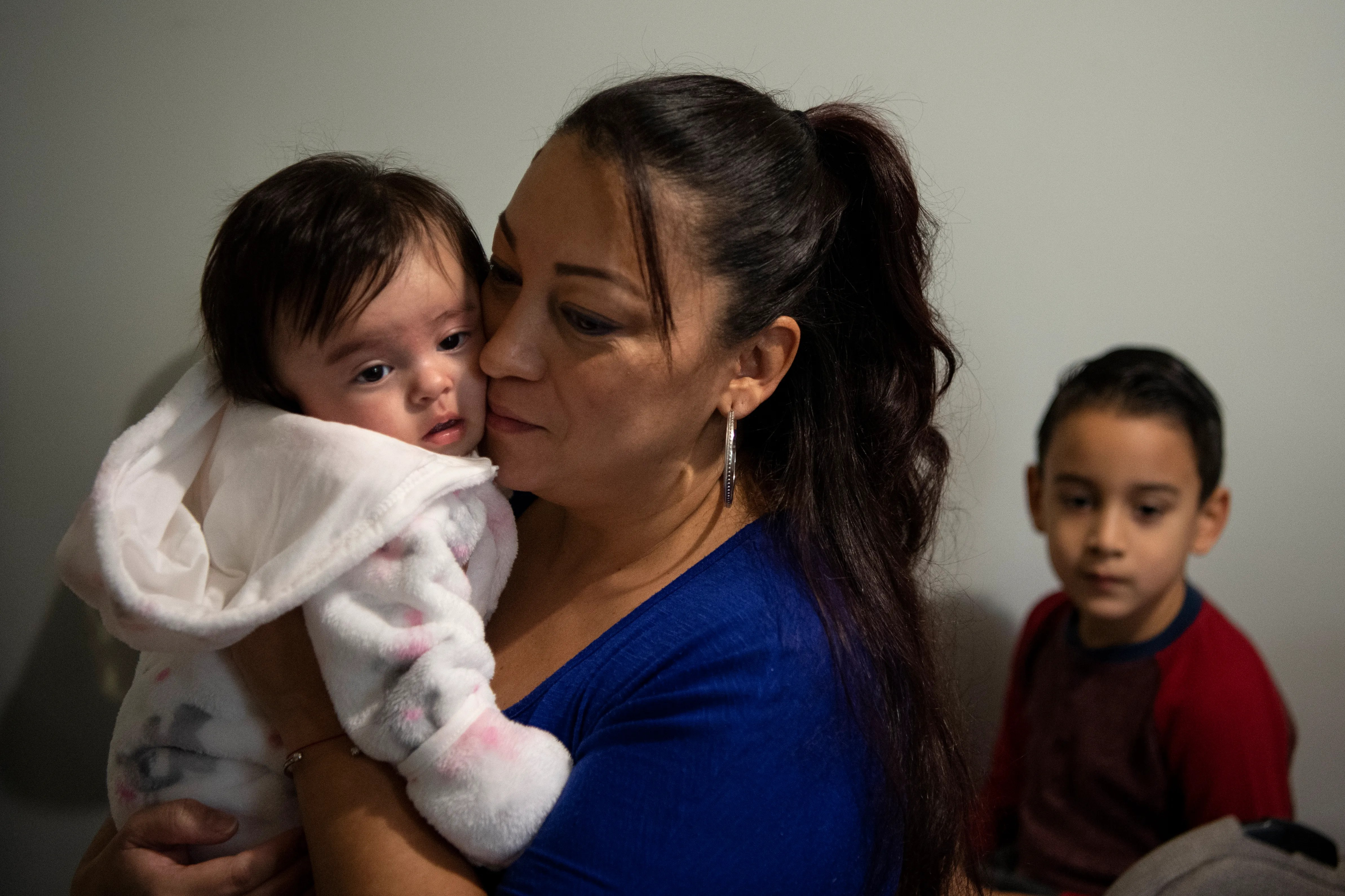 Luz Vanegas holds her granddaughter Emma at her home in North Bergen on Friday, November 13, 2020. (Right) Her son Jacob Bravo, 6. Vanegas' life turned upside down this summer when her daughter, Estefania, gave birth to her first grandchild and suffered a heart attack during delivery leaving her in a coma. Vanegas not only worried about her daughter, but also began to take care of her new granddaughter, Emma, while her father works and they figure out what happened to Estafania. Meanwhile, Vanegas is also facing deportation.