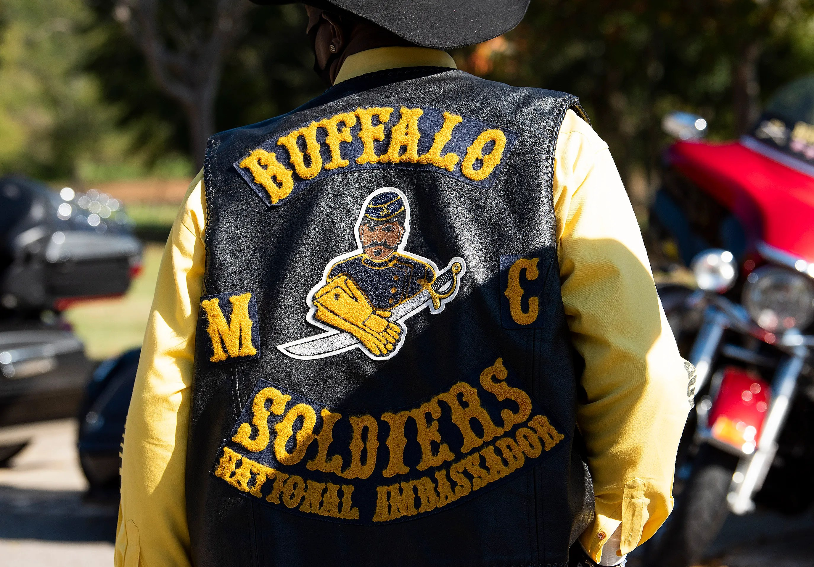 """The back of the vest of a Buffalo Soldiers Motorcycle Club member displays founder Kenneth """"Dream Maker"""" Thomas as its centerman patch."""