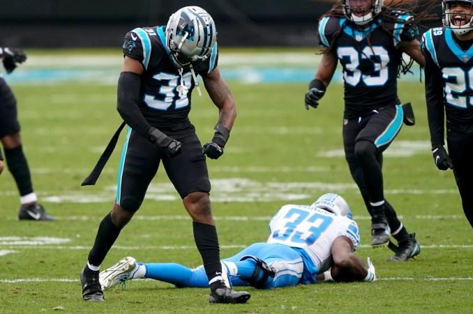 Carolina Panthers strong safety Juston Burris celebrates after tackling Detroit Lions running back Kerryon Johnson during the first half.