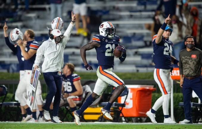 Auburn defensive back Smoke Monday (21) returns an interception for a touchdown at Jordan-Hare Stadium in Auburn, Ala., on Saturday, Nov. 21, 2020. Auburn defeated Tennessee 30-17.