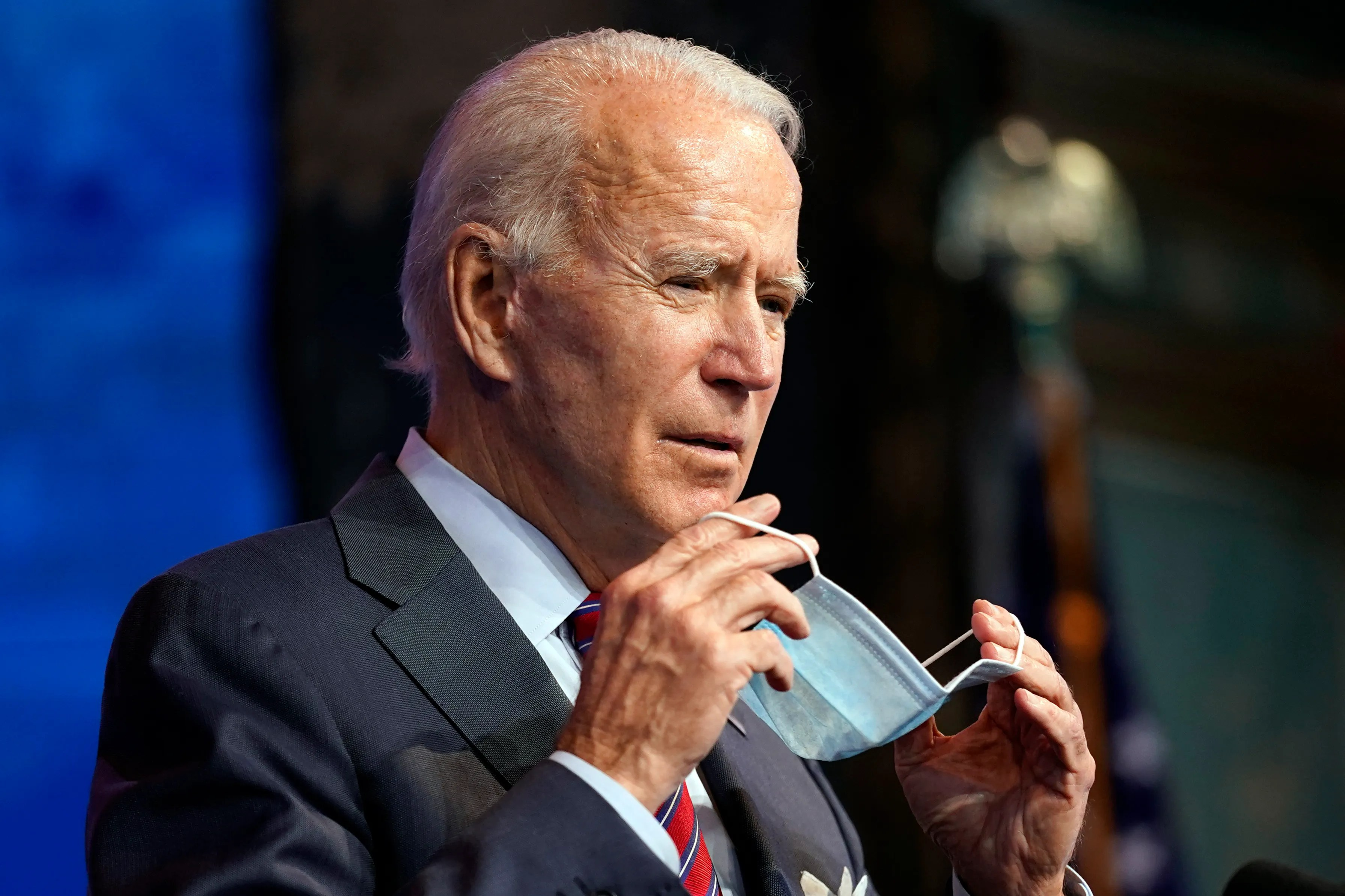 President-elect Joe Biden puts on his face mask after speaking about jobs at the Queen Theater, Friday, December 4, 2020, in Wilmington, Delaware.