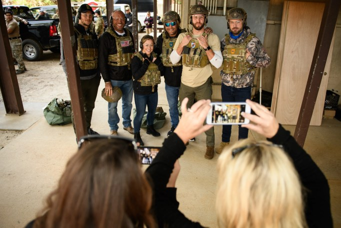 A group of celebrities, Andrew East, left to right, Randy Couture, Shawn Johnson, Jeffrey Henderson, Shawn Booth and Chuck Wicks, pose for a picture before watching Special Forces soldiers put on a demonstration on Wednesday, Dec. 9, 2020, on Fort Bragg. The celebrities are visiting Fort Bragg to take part in the Special Forces Tactical Challenge.