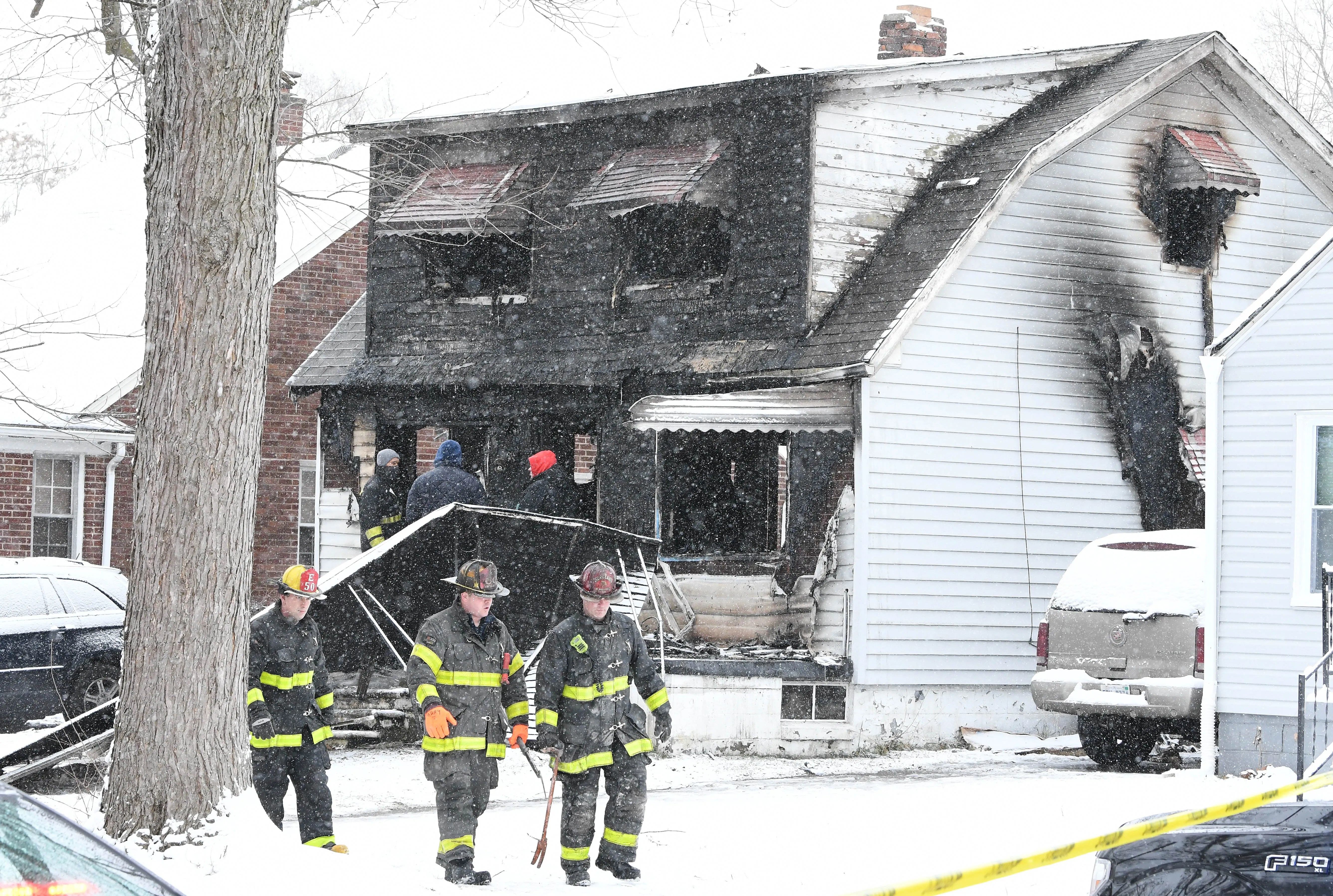 Firefighters at the scene of a fire in a house in the 20000 block of Helen Ave. in Detroit, Michigan  on Friday, December 25, 2020.