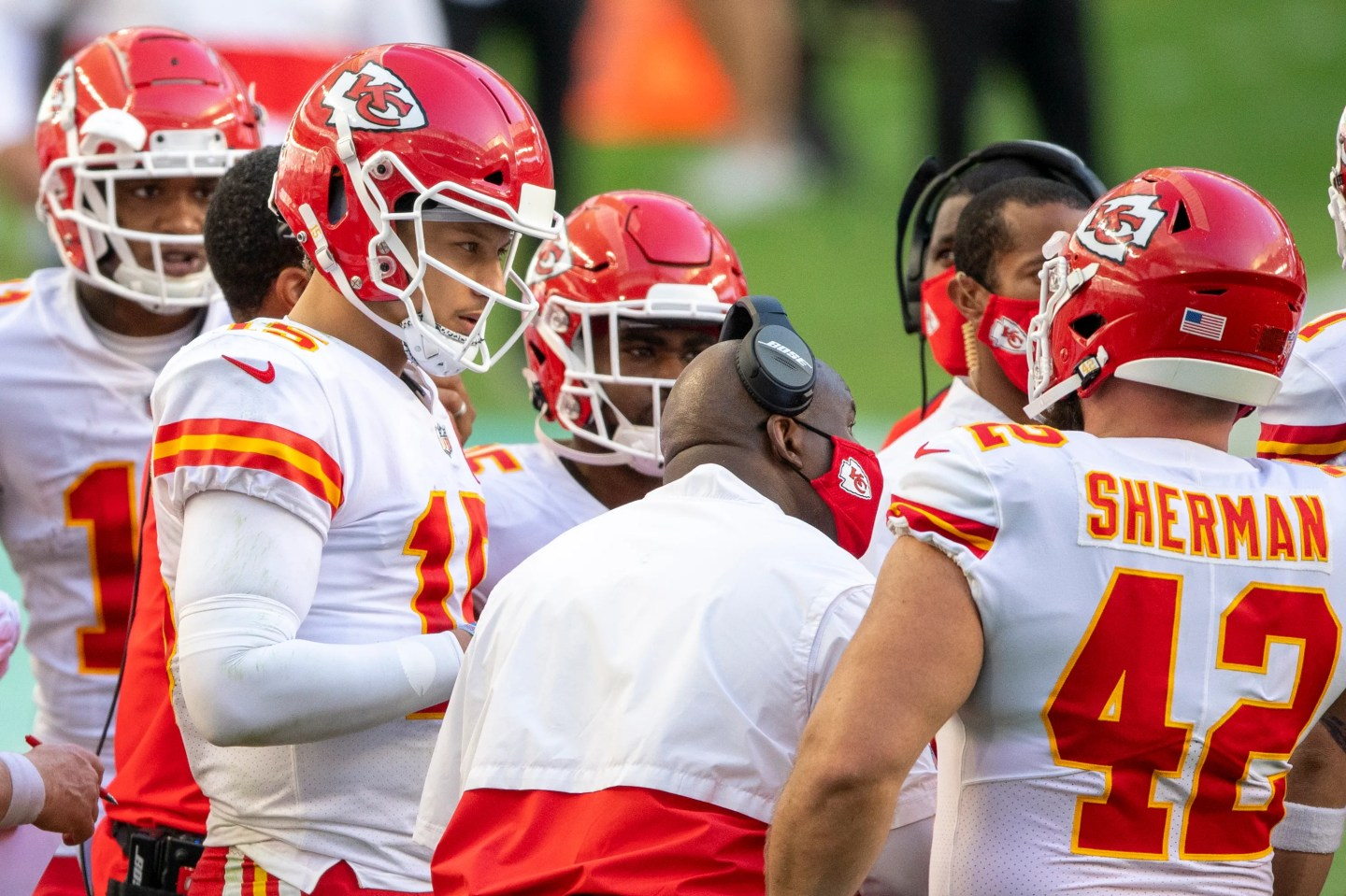 Patrick Mahomes, left, listens to Eric Bieniemy on the field and off it as the two have developed a close relationship