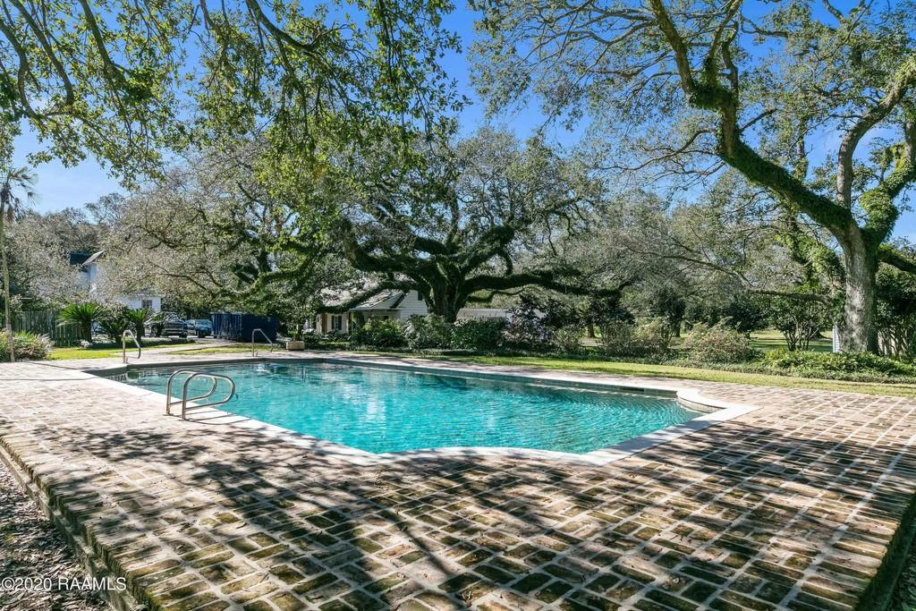 The grounds, a stunning 6.31-acre lot, encompassescentury-old Live Oak trees, a pool andan established rose garden with an arbor.  Originally built in 1935, this Abbeville mansion is anything but your average historical Acadian mansion with an elevator, sauna,cabana, rose garden andwell on the property.