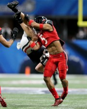 Cincinnati Bearcats safety Darrick Forrest (5) tackles Georgia Bulldogs wide receiver Cameron Moore (85) in the first quarter during the Chick-fil-A Peach Bowl, Friday, Jan. 1, 2021, at Mercedes-Benz Stadium in Atlanta, Georgia.