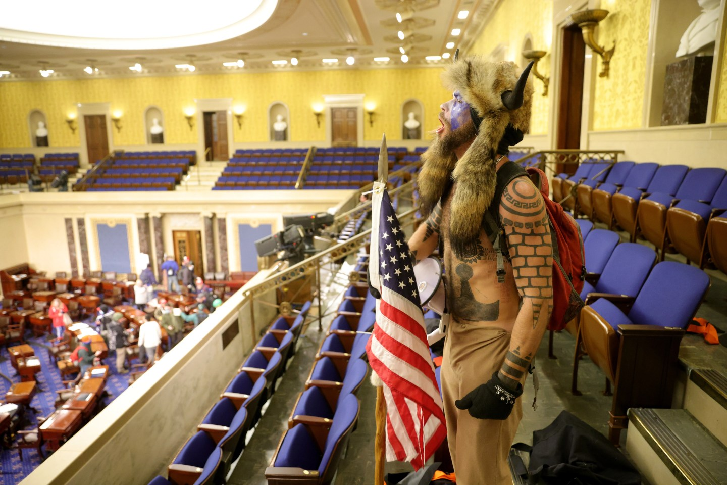 Jacob Anthony Chansley, aka Jake Angeli of Phoenix, yells inside the Senate chamber on Jan. 6, 2021, in Washington, D.C. Congress held a joint session to ratify President-elect Joe Biden's 306-232 Electoral College win over President Donald Trump. Pro-Trump protesters entered the U.S. Capitol during mass demonstrations in the nation's capital.