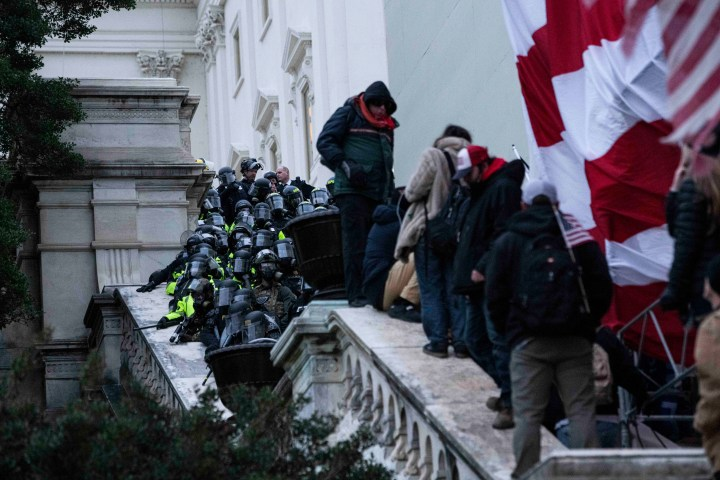 Police tried in vain to keep protesters off the Capitol steps.