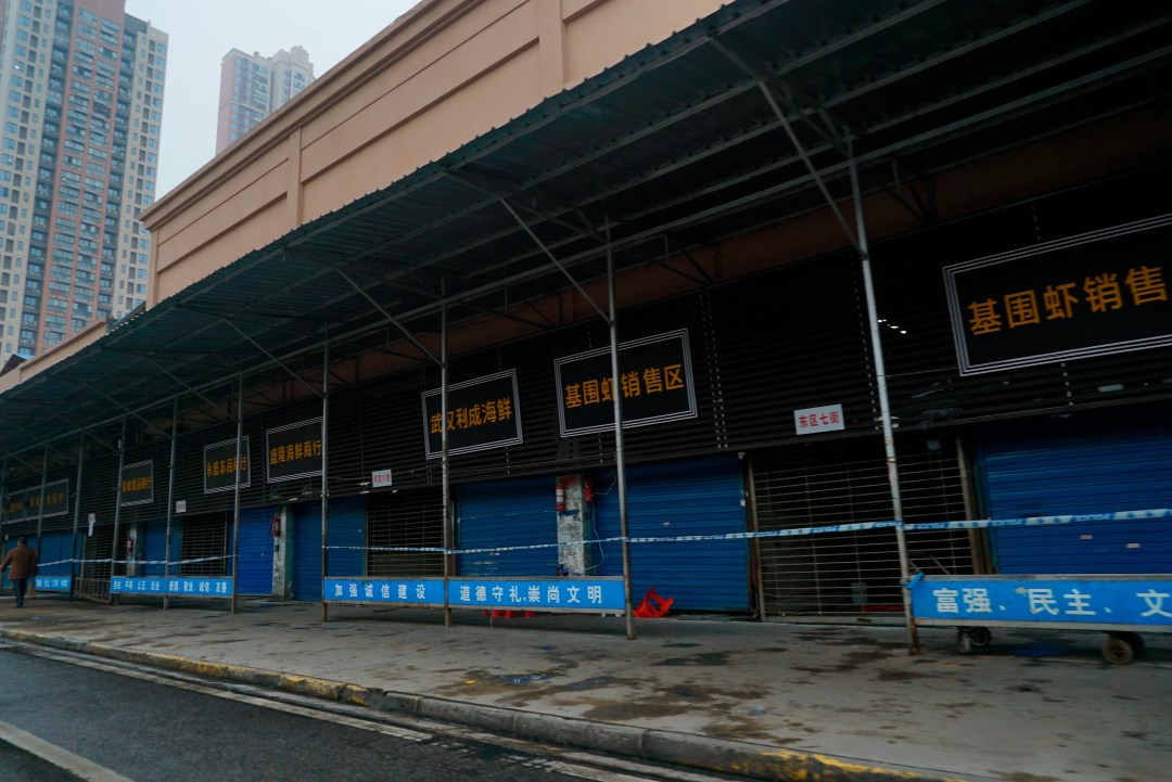 The Wuhan Huanan Wholesale Seafood Market, where a number of people related to the market fell ill with a virus, sits closed in Wuhan, China, Tuesday, Jan. 21, 2020.