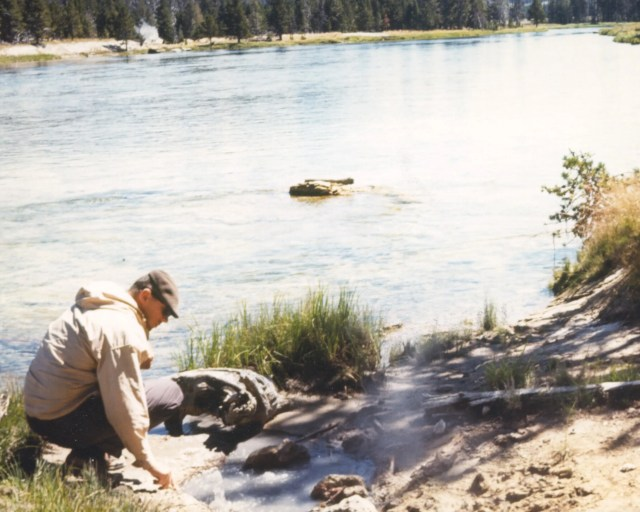 Microbiologist Tom Brock collects one of his first samples from the Yellowstone River in 1964. A pioneer in his field, Brock's discovery of bacteria that can live in extremely high temperatures led to major advancements in biology and medicine, including the technology that is used in COVID-19 PCR tests.