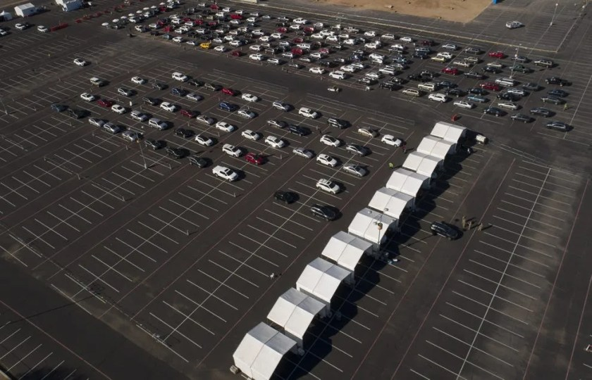 A large line of cars is seen in this aerial shot at the COVID-19 vaccination center at State Farm Stadium in Glendale, AZ.