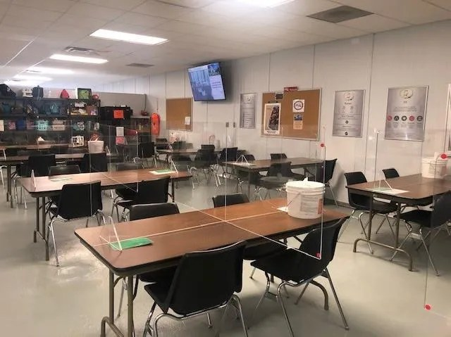 The Seneca Foods premises in Gillett taken on July 21, 2020, according to records of the Wisconsin Department of Workforce Development. One of the workers said the photo shows the plant's cafeteria. Tables are set up with dividers to separate employees.