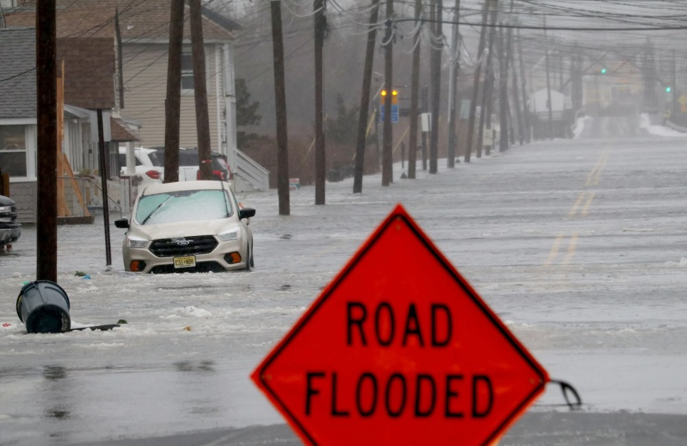 A car sits in flood waters along Brielle Road in Manasquan Monday morning, February 1, 2021.