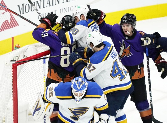 Feb 13, 2021; Glendale, Arizona, USA; St. Louis Blues center Ryan O'Reilly (90) goes after Arizona Coyotes right wing Conor Garland (83) in the first period at Gila River Arena. Mandatory Credit: Rob Schumacher-Arizona Republic