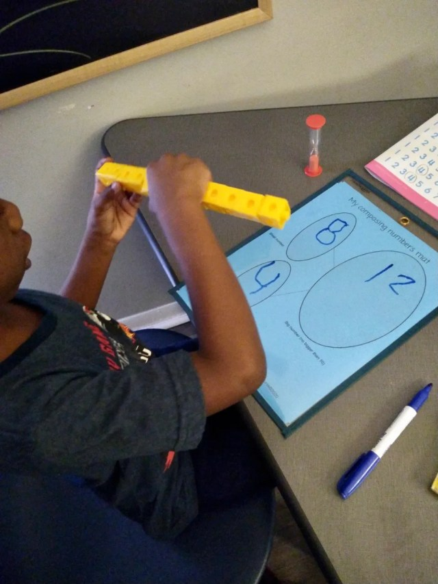 Moses Johnson, a homeschooled kindergartner in Charleston, South Carolina, works on a math assignment.