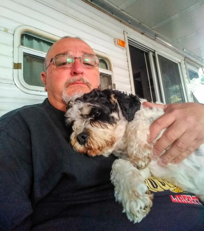 Ron Packard and his dog Dominic two weeks before the dog passed. (Photo provided by Ron Packard)