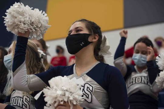 Feb. 27, 2021; Anthem, AZ, USA; North Valley Christian Academy's women's basketball player and cheerleader Bella Smith cheers for the men's basketball team from the sidelines at North Valley Christian Academy on Feb. 27, 2021. Credit: Meg Potter/The Arizona Republic