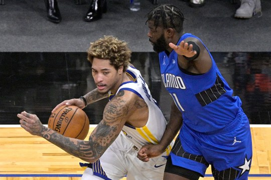 Golden State Warriors guard Kelly Oubre Jr., left, drives to the basket in front of Orlando Magic forward James Ennis III (11) during the first half of an NBA basketball game, Friday, Feb. 19, 2021, in Orlando, Fla. (AP Photo/Phelan M. Ebenhack).