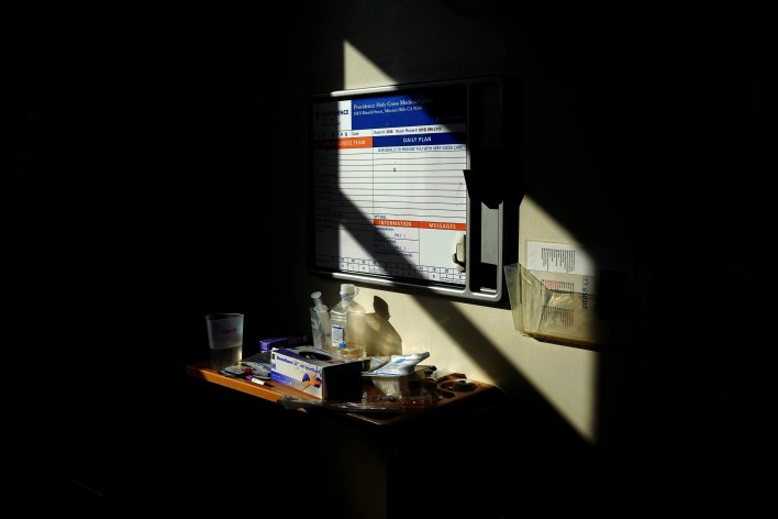 The sun beams across medical supplies in an intensive care room on Tuesday, Feb. 9, 2021, at Providence Holy Cross Medical Center in Los Angeles.
