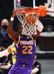 Mar 4, 2021; Phoenix, Arizona, USA; Phoenix Suns center Deandre Ayton (22) slam dunks the ball against the Golden State Warriors in the first half at Phoenix Suns Arena. Mandatory Credit: Mark J. Rebilas-USA TODAY Sports