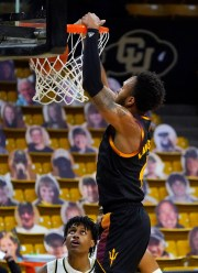 Arizona State forward Kimani Lawrence, front, dunks for a basket as Colorado forward Jabari Walker watches in the first half of an NCAA college basketball game Thursday, March 4, 2021, in Boulder, Colo. (AP Photo/David Zalubowski)