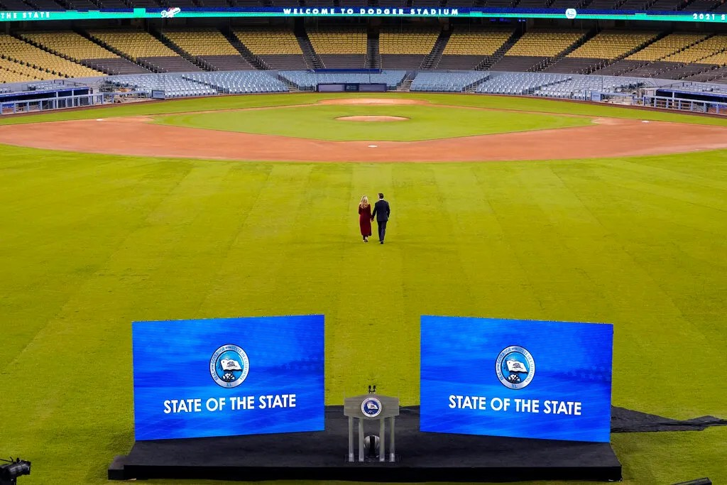 California Gov. Gavin Newsom and his wife Jennifer Siebel Newsom walk away from the stage after he delivered his State of the State address from an empty Dodger Stadium Tuesday, March 9, 2021, in Los Angeles.