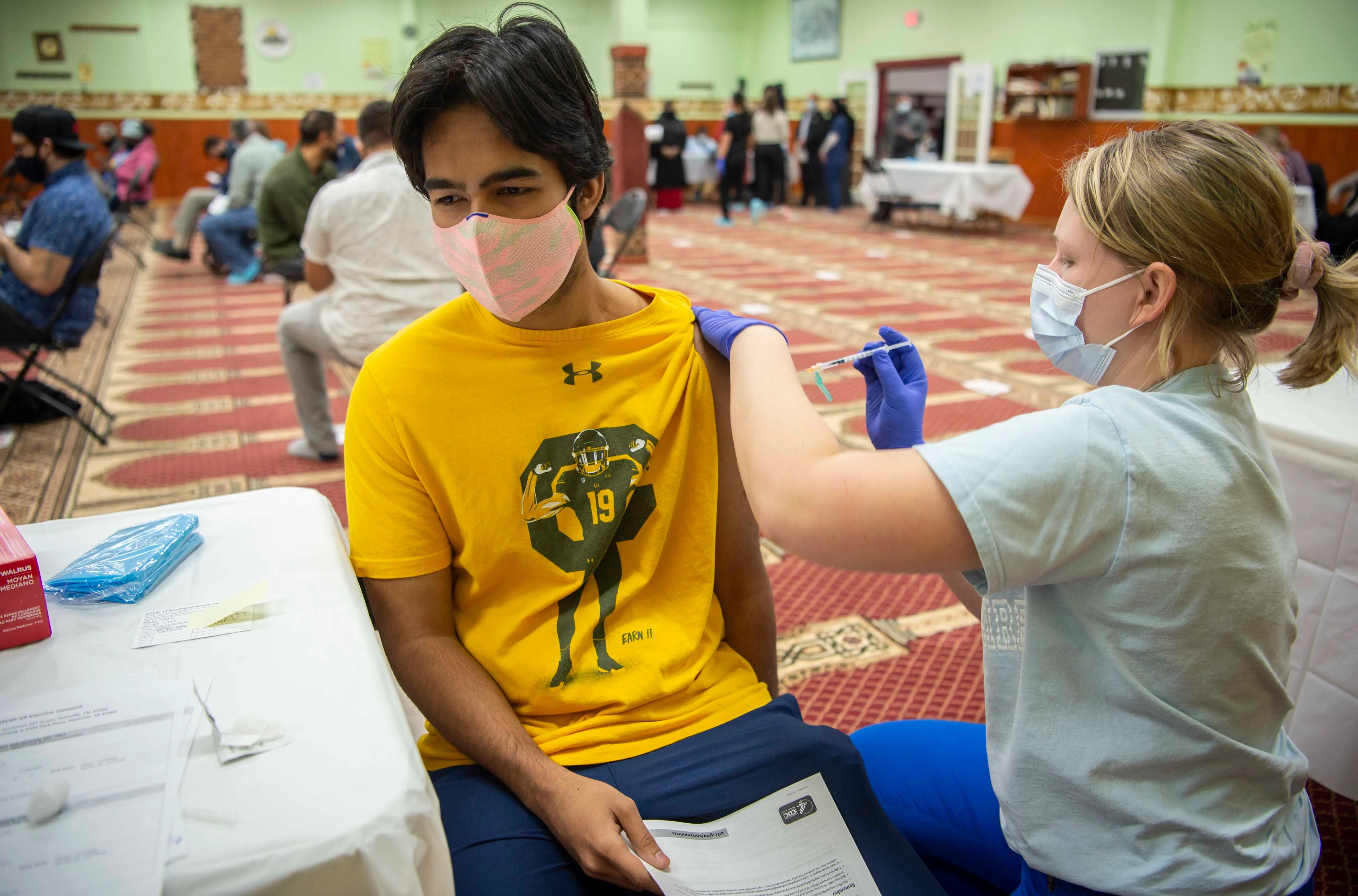 Ibrahim Mobyuddin receives his COVID-19 vaccine from APRN Molly Shine at the Salahadeen Center in Nashville, Tenn. On Thursday, March 11, 2021. The Salahadeen Center has partnered with the Metro Health department to serve the Kurdish community and all sub-communities. represented by hosting the COVID-19 vaccination clinic inside the mosque.