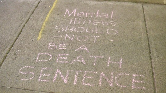 A message written in chalk outside of the Open Door Mission at 210 W. Main St.