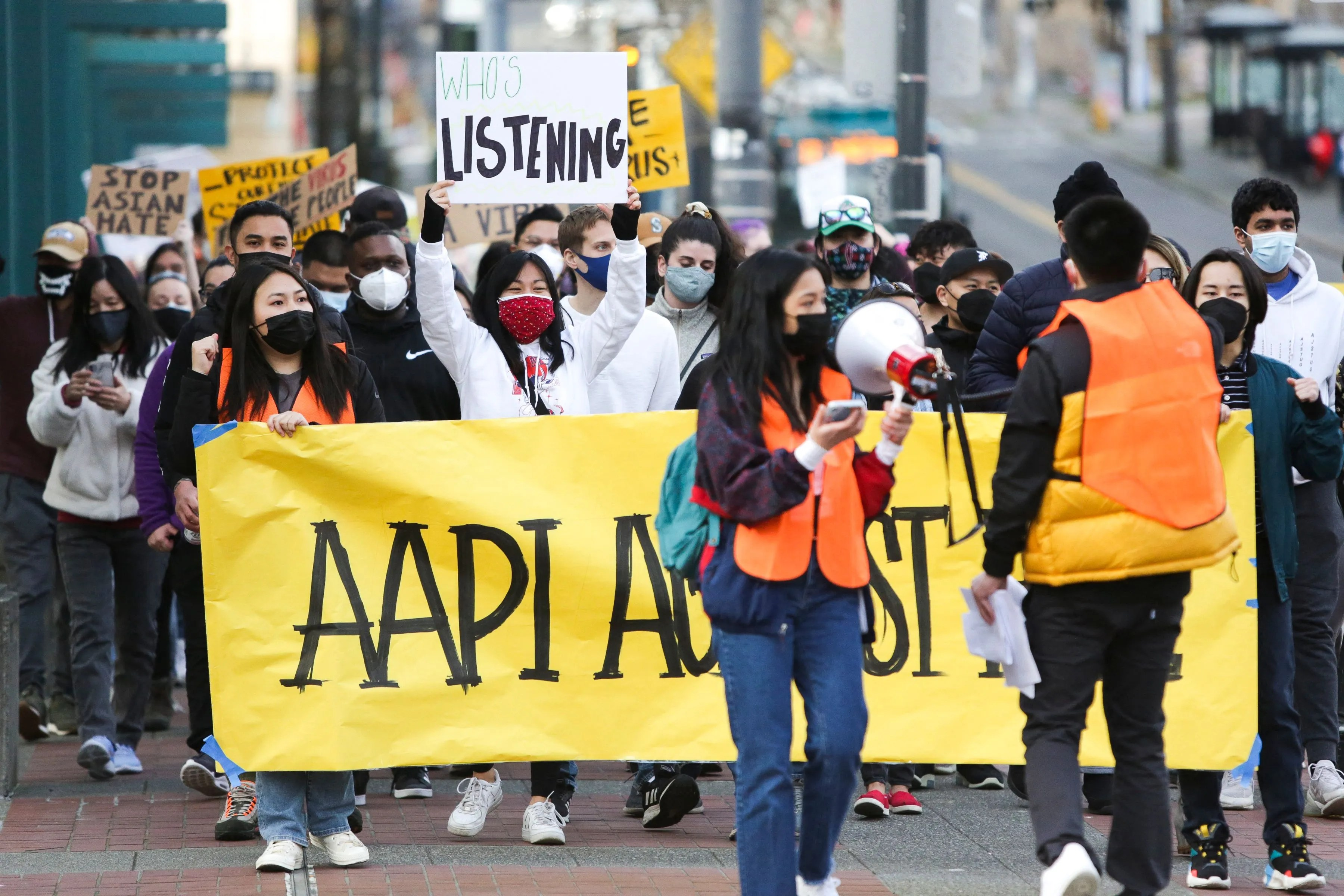 """People march during the """"We Are Not Silent"""" rally against anti-Asian hate in response to recent anti-Asian crime in the Chinatown-International District of Seattle on March 13, 2021."""