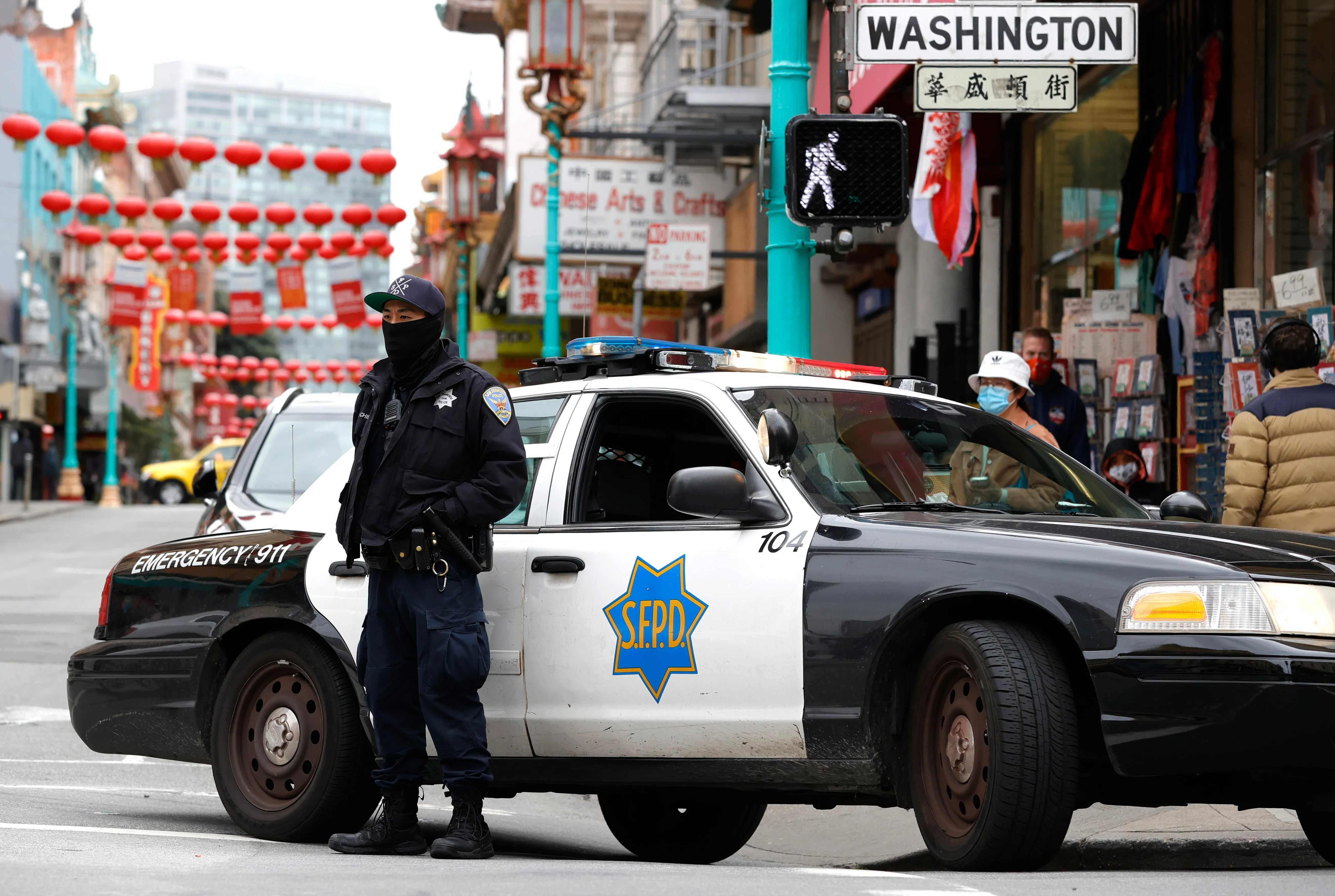 A San Francisco police officer stands guard on Grant Avenue in Chinatown on March 17, 2021 in San Francisco, California. The San Francisco police have stepped up patrols in Asian neighborhoods in the wake of a series of shootings at spas in the Atlanta area that left eight people dead, including six Asian women. The main suspect, Robert Aaron Long, 21, has been taken into custody. The San Francisco Bay Area is also seeing an increase in violence against the Asian community.