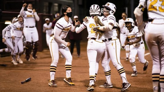 No. 14 ASU softball celebrates its walk-off win Friday night over No. 6 Washington.