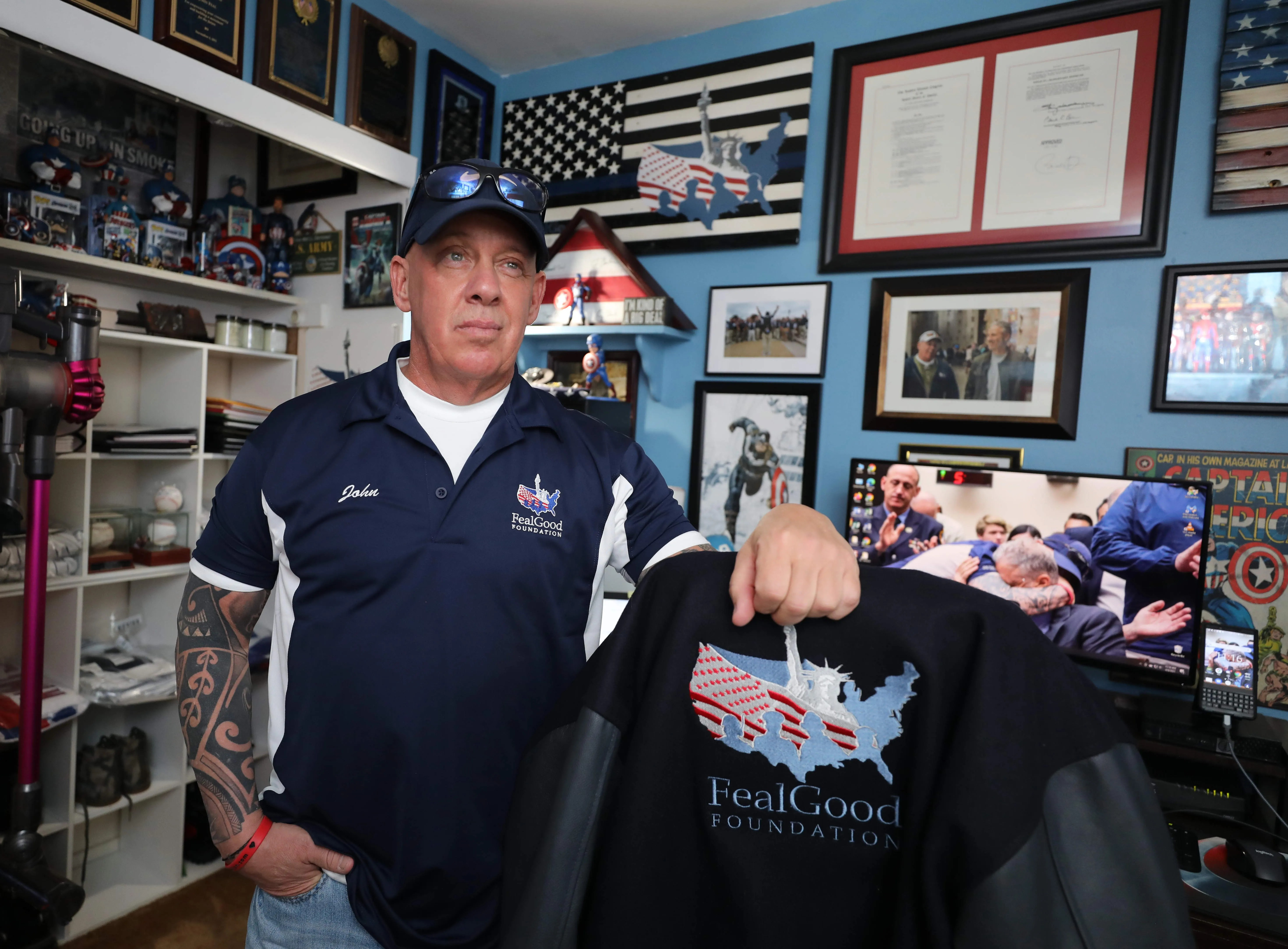 John Feal is pictured in his home office in Nesconset, New York, April 6, 2021. Feal, who established the FealGood Foundation, has become a leading activist in getting the 9/11 James Zadroga Act, the WTC Health Program and the 9/11 Victims Compensation Fund, passed and then renewed and then made permanent.