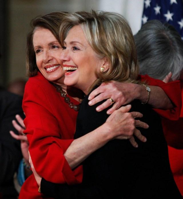 House Speaker Nancy Pelosi hugs then-Secretary of State Hillary Rodham Clinton during a 2010 Women History Month celebration.