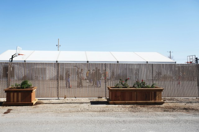 Migrant children play outside at a shelter for unaccompanied minors on April 9, 2021, in Pecos, Texas. The property is owned by Target Hospitality. It was formally being used by oil field workers for lodging while at a job work site. It is now housing migrant children.