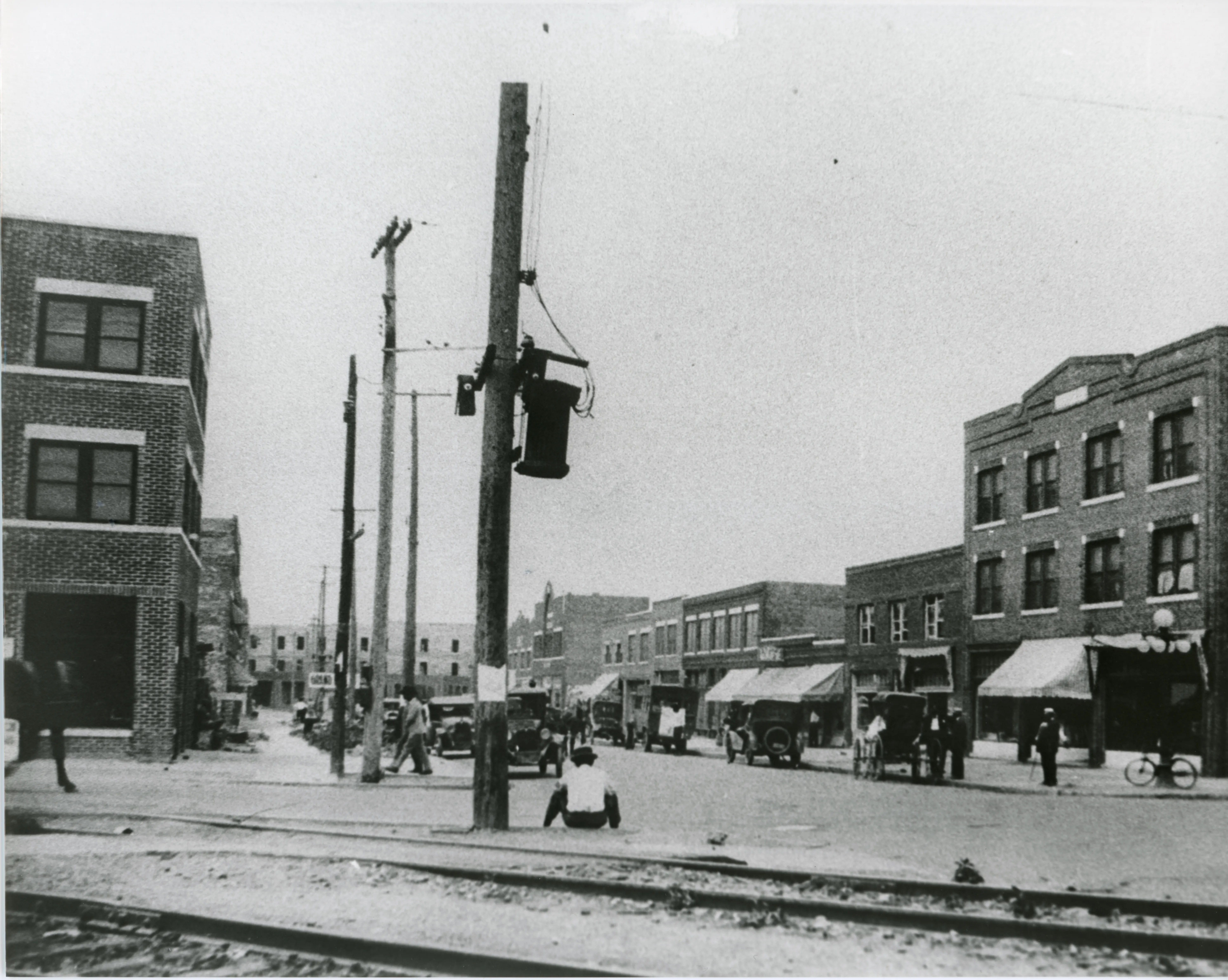 Greenwood Avenue in Tulsa after the reconstruction of the Greenwood District after the 1921 Tulsa Race Massacre. The three-story, brick Botkin Building is visible on the far right. It replaced a two-story brick building that stood before the massacre. The building on the far left is the reconstructed Williams Building completed in 1922.