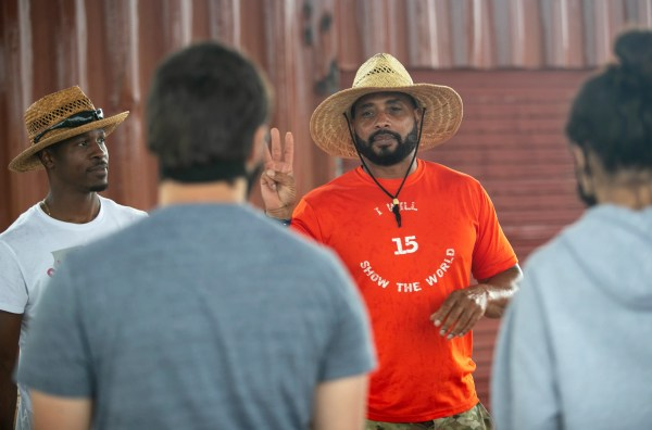 Jesse Bryson, the President and CEO of the I Will Mentorship Foundation, directs FGCU student volunteers at the organization's urban farm on Tuesday, April 20, 2021.