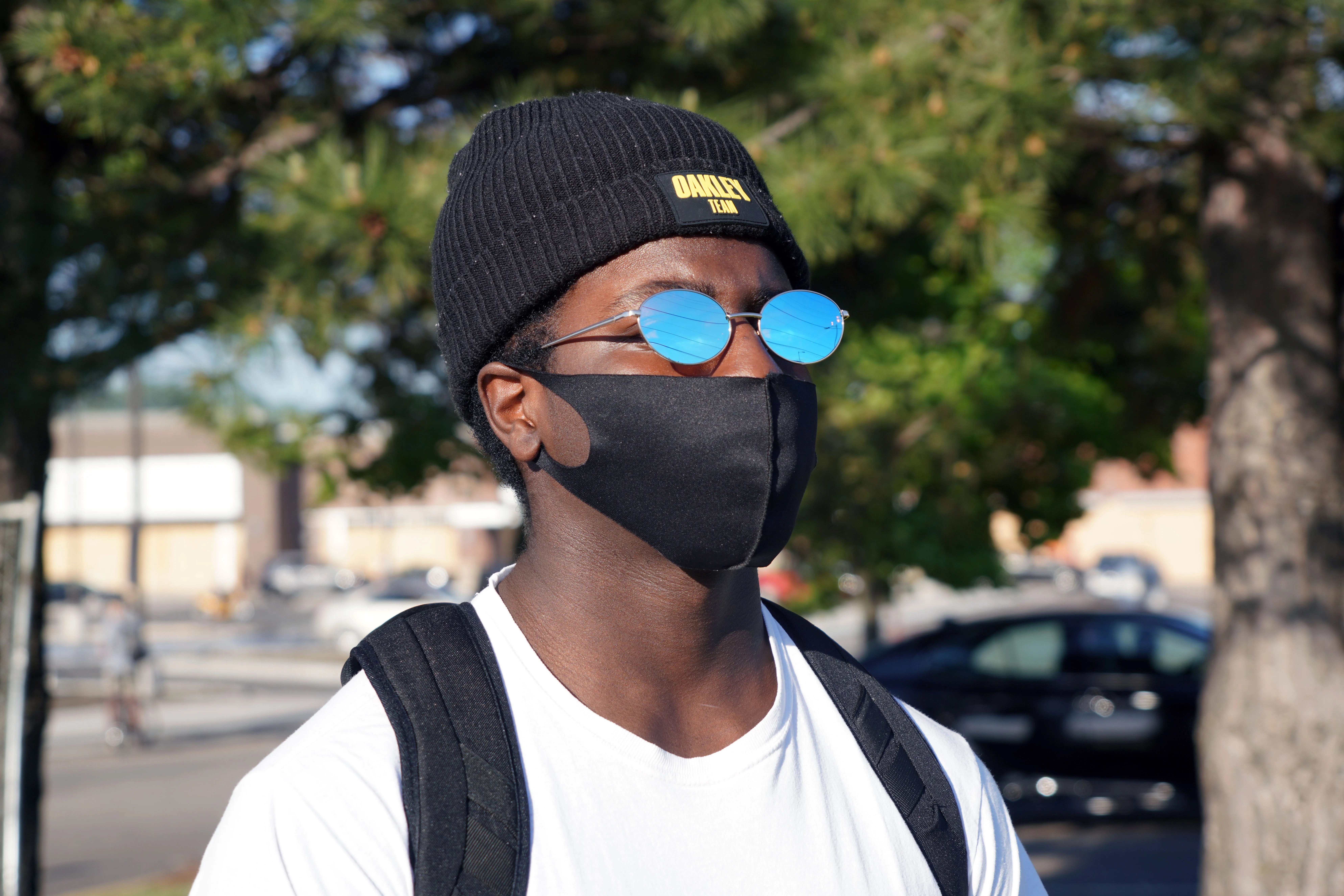 Emo Ismail, 17, watches a protest in honor of George Floyd on Thursday, May 28, 2020, in Minneapolis.