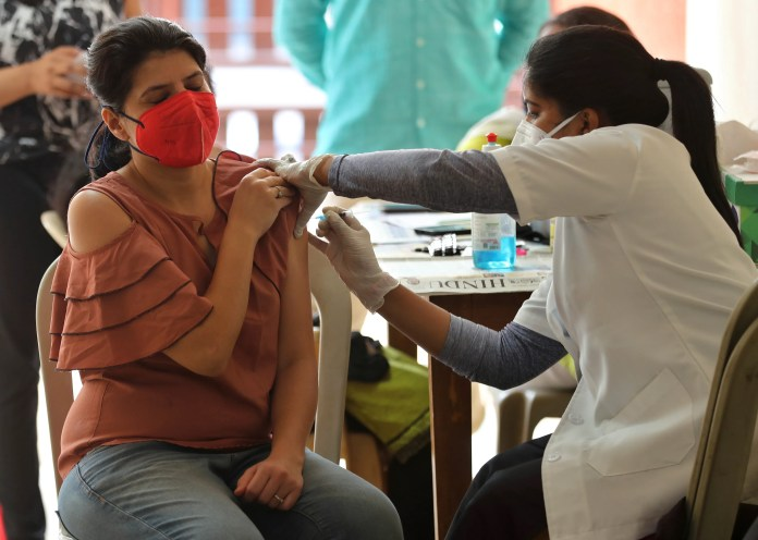 CDC guidelines say vaccinated people don't need to wear masks outside