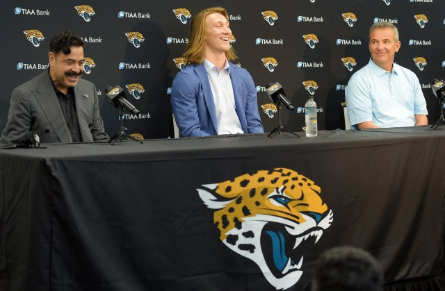 Jaguars owner Shad Khan, quarterback Trevor Lawrence and head coach Urban Meyer share a moment of levity during Friday afternoon's press conference at TIAA Bank Field.