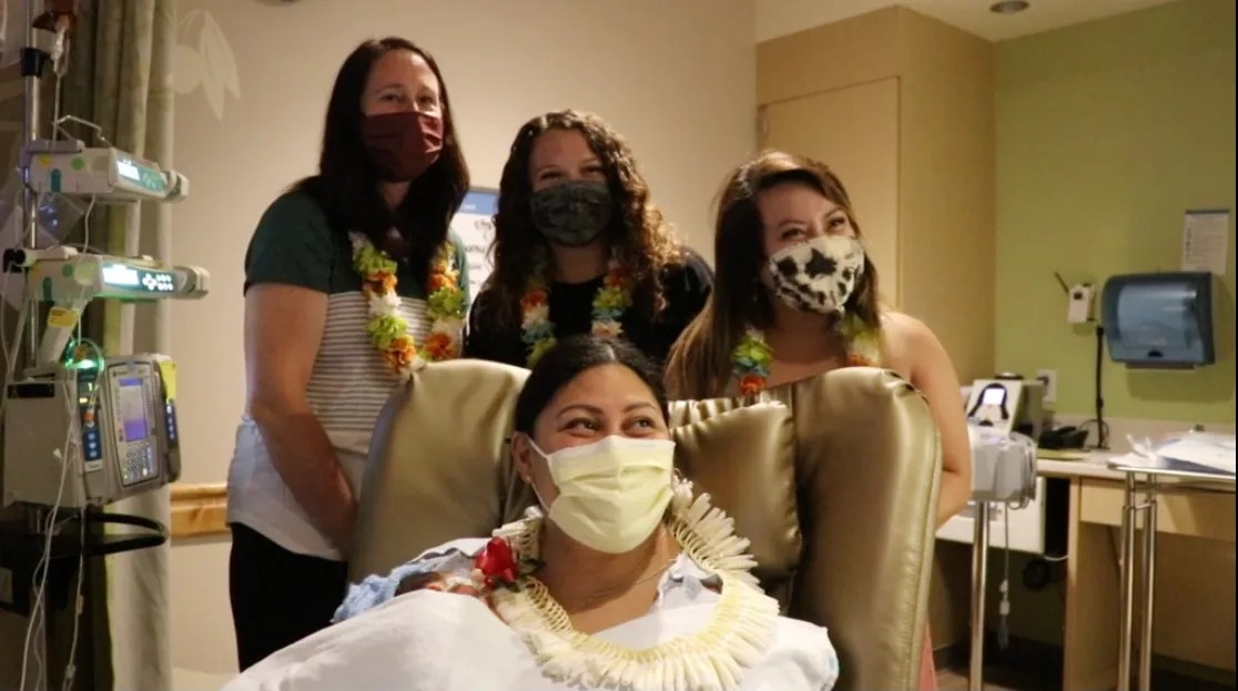 New mother, Lavinia Mounga with the three nurses from the NICU who helped her give birth on the plane.