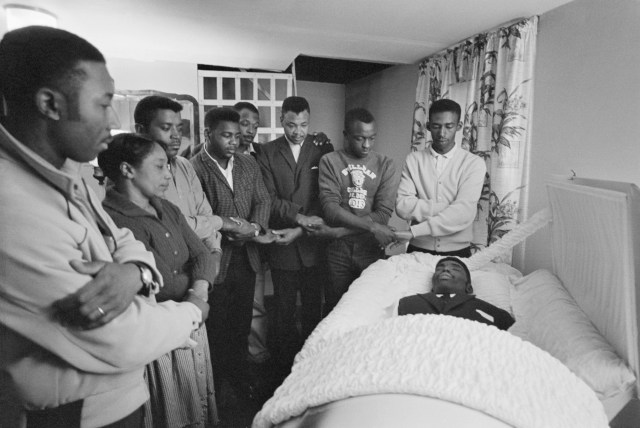 Mourners gather near the body of Jimmie Lee Jackson, who died days after being shot on Feb. 18, 1965, by an Alabama state trooper during a civil rights protest in Marion, Alabama. As this photo is from an archive, names of the mourners are not available.