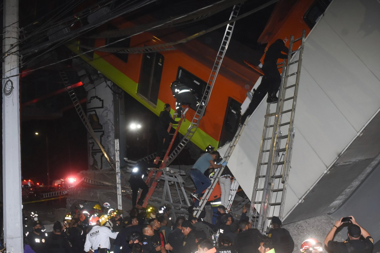 Mexico City firefighters and rescue workers show victims recovering after an overpass in a Mexico City metro crashed on a road Monday night.
