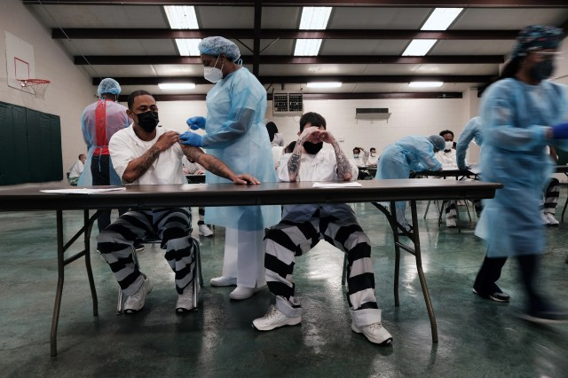 Prisoners at the Bolivar County Correctional Facility in Cleveland, Mississippi, receive a COVID-19 vaccination administered by medical workers with Delta Health Center on April 28, 2021. The prisoners, part of a population particularly vulnerable to COVID-19, are given a choice between the one-shot Johnson & Johnson vaccine and one from Moderna. (Photo by Spencer Platt/Getty Images)