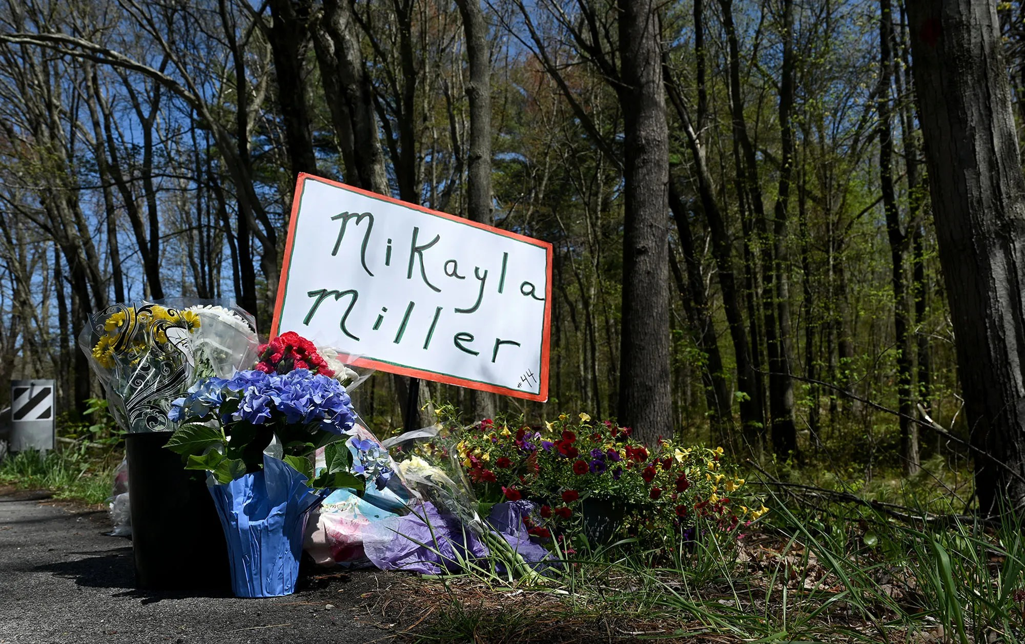 Growing memorial to Mikayla Miller, 16,  on West Main Street in Hopkinton, near a wooded area where she was found dead near her Hopkinton home on April 18, seen before a rally to both honor Miller and to call for answers from authorities on the cause of her death, Thursday, May 6, 2021.
