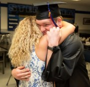 Brandon Zimmermann gets a hug from his mom, Nadine, after graduating from Universal Technical Institute in Avondale and getting a surprise job offer.