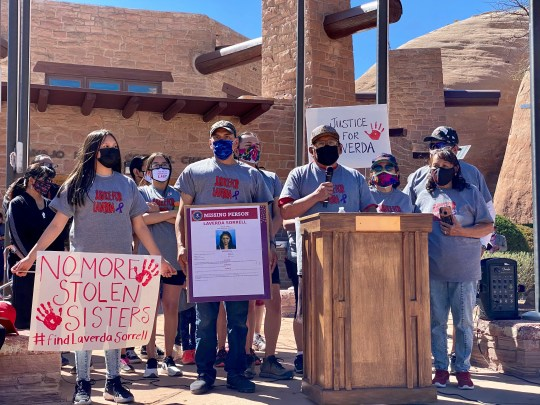 Charles Guy Jr. stands at the podium with his family as he talks about his sister Laverda Sorrel. His sister went missing in 2002 and her case is still unsolved. The family hosted a walk in her honor as part of awareness day event for Missing and Murdered Indigenous Women and Girls on May 5, 2021.